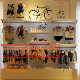 Китай Kids clothing kiosk design with clothing display racks завод