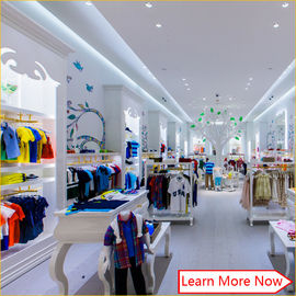 Китай Customized nice design fashion white wooden kids clothing store interior design,kids baby shop design decoration завод