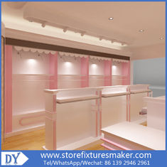 Китай Factory OEM Supplier mdf  wooden  in pink white lacquer Baby Girl Clothing Stores display furnitures завод