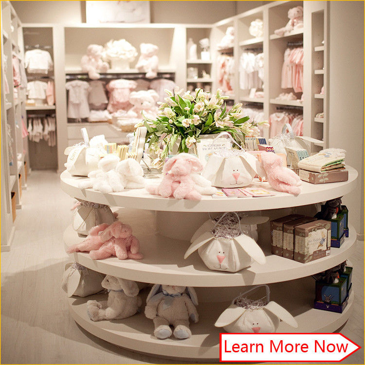 Customized high quality baby kids clothes store interior design поставщик
